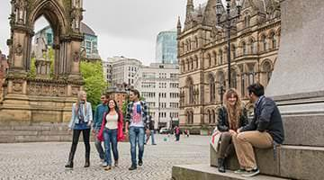 Kaplan students out front of Manchester Town Hall