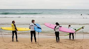 Kaplan students learning to surf in Australia