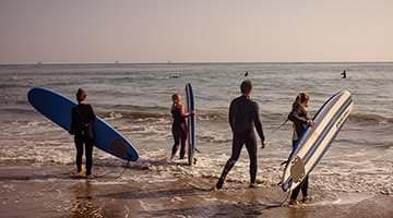 Kaplan students learning to surf in Santa Barbara