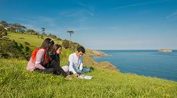 Kaplan students exploring the cliffs of Torquay