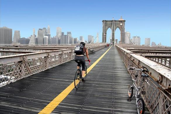 Kaplan student cycling in a bridge in New York