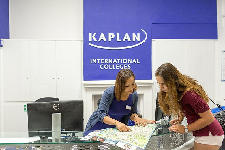 Student asking for directions in Kaplan's school reception