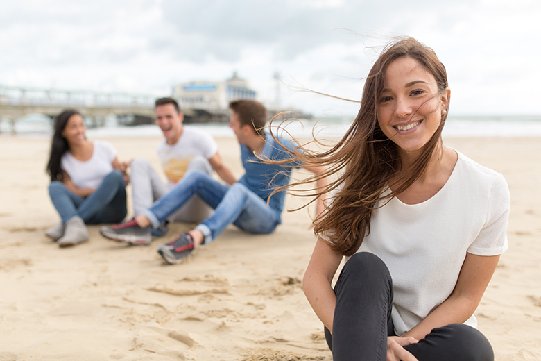 students relaxing at a Bournemouth beach