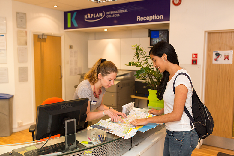 Student ask for directions in the reception of the Kaplan English school in Bournemouth