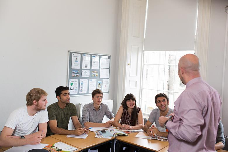 Teacher and students at an English course at Kaplan Edinburgh
