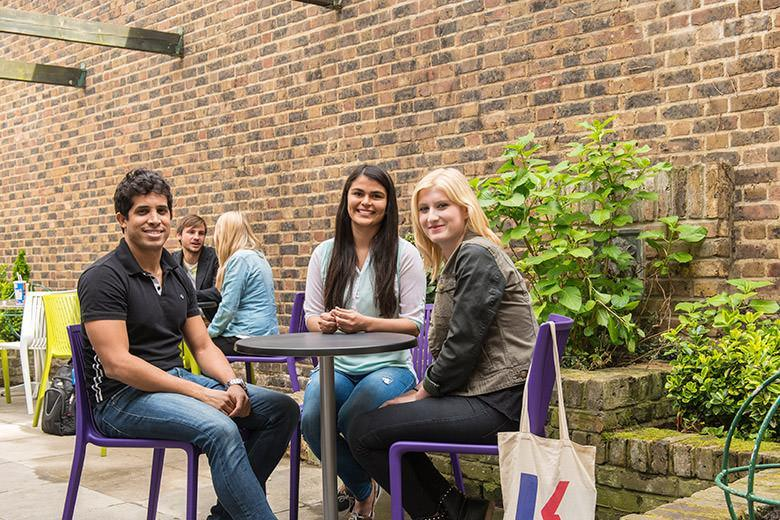 Students sitting in the outdoor area of the Covent Garden English school