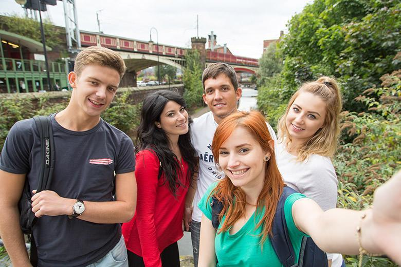 International students taking selfies in Manchester