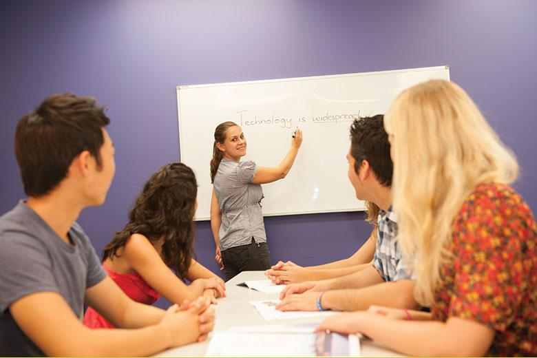 Teacher and students during an English course at Kaplan Perth