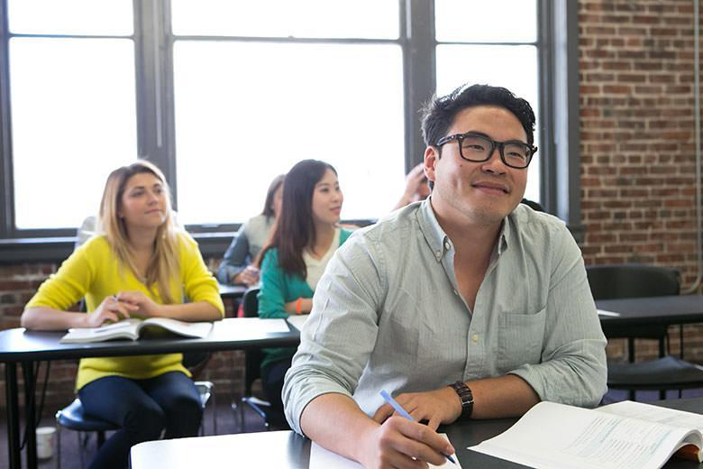 Adult students during an English class in the San Francisco Kaplan school