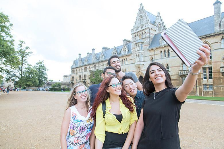 International students taking selfies in Oxford