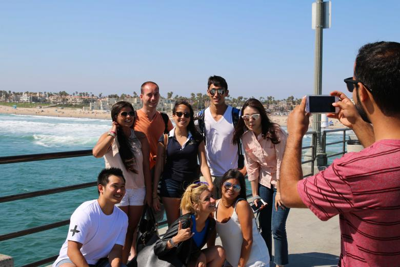Adult students having fun in Huntington Beach