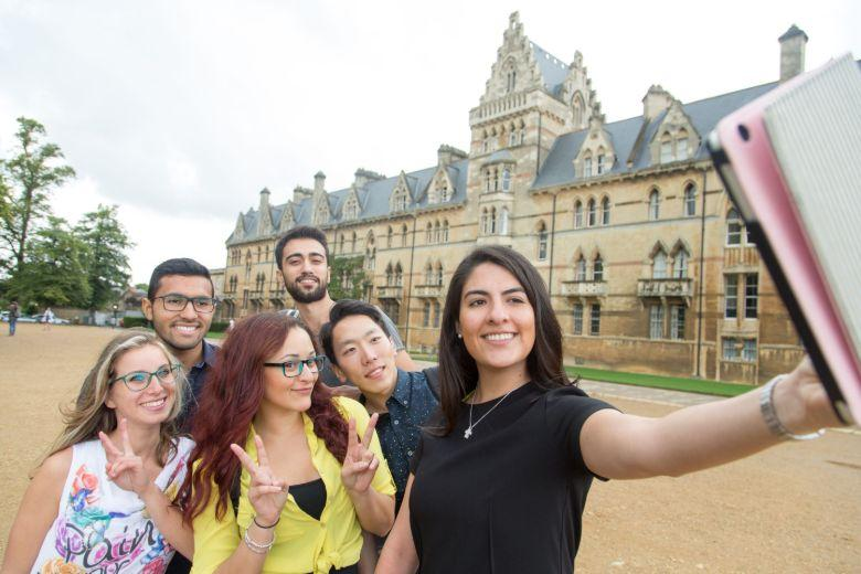 International students taking a selfie next to Christ Church College in Oxford