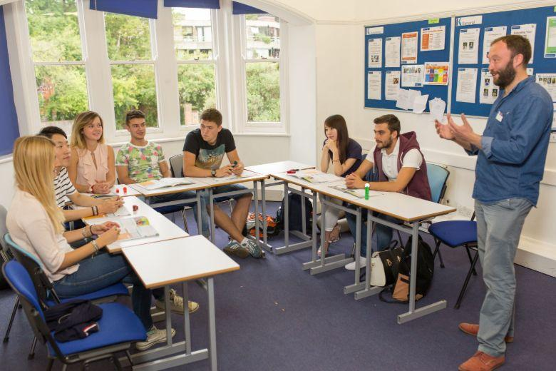 Kaplan students and teacher during a class at the Oxford School