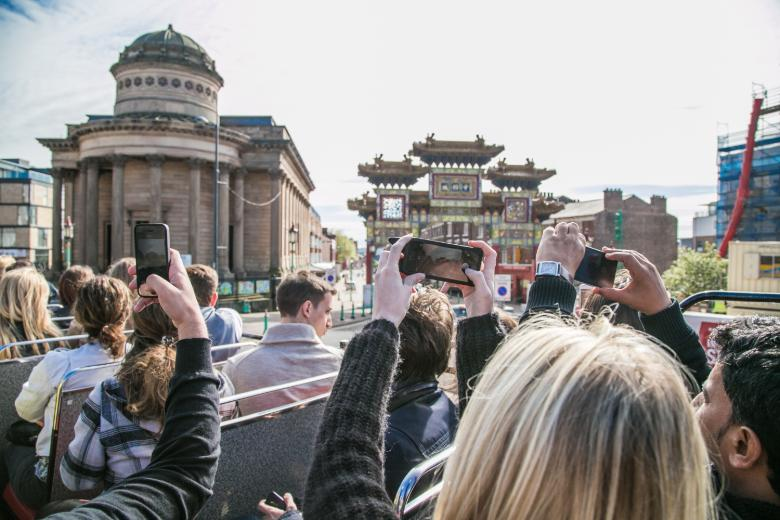 Kaplan International students discovering Liverpool on a open-top bus tour