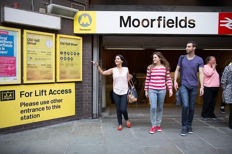 Kaplan International students walking out of Moorfields station in Liverpool